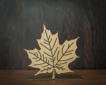 A metal bookend Maple Leaf Golden Metallic by Atelier Article, Golden