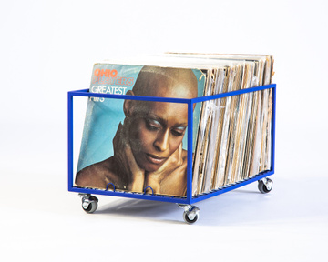Record holder on rotating wheels holds over 100 LP records by Atelier Article, Blue