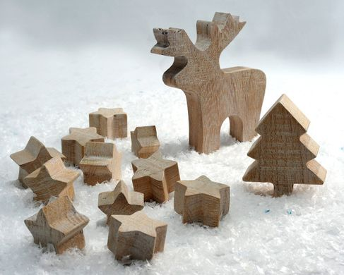 Wooden Christmas ornaments. 11 stars, one moose and a tree by Atelier Article